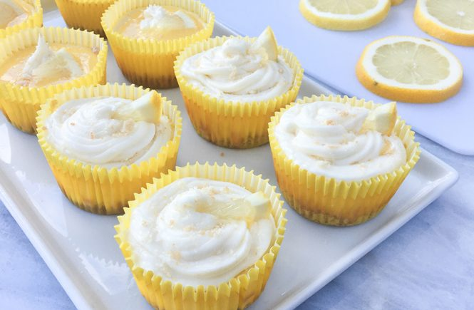 Lemon Curd Cheesecake Cupcakes on Plate with Lemon Garnish