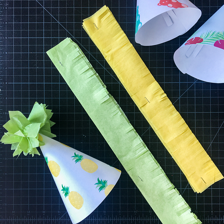 Cutting Tissue Paper Fringe for DIY Paper Party Hats